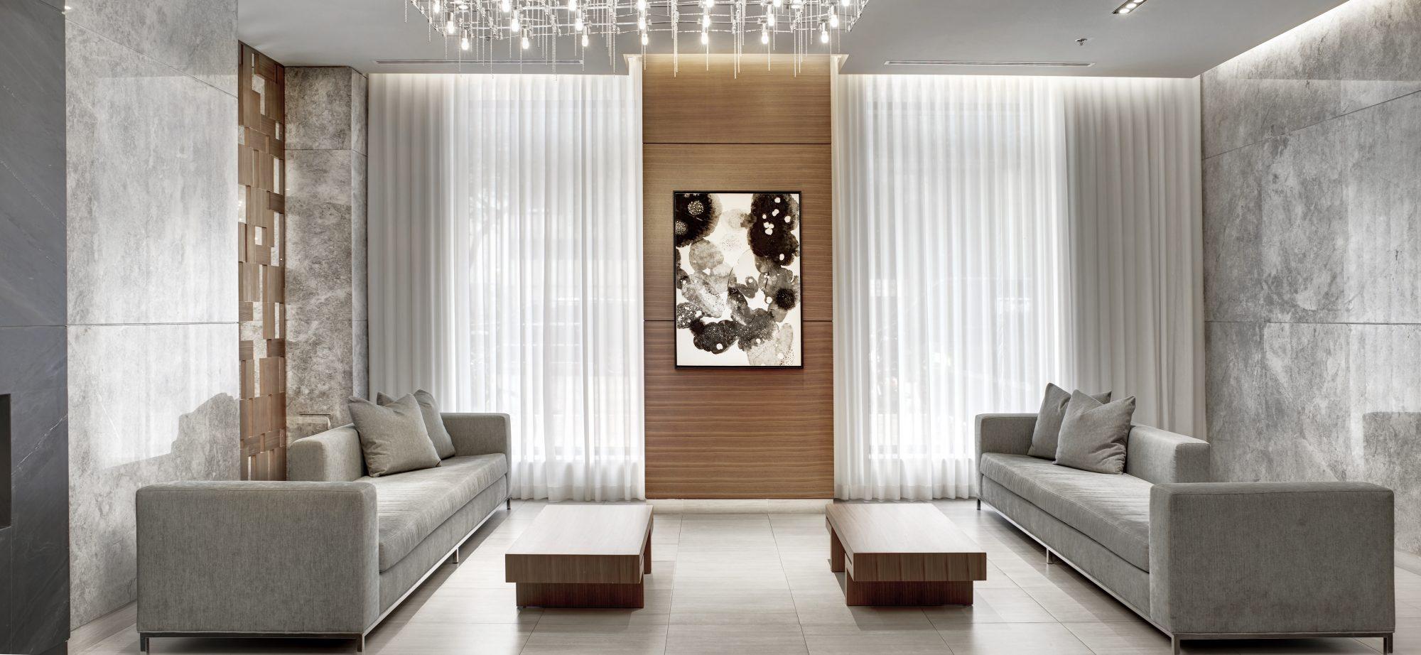 Grey lobby with light fixture